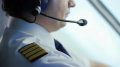 Tired air crew commander navigating airliner, responsible job, commitment - stock footage