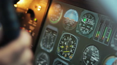 Flight control desk with changing indicators, pilot's hands on steering wheel Stock Footage