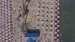Aerial shot.Top view of crowded beach in sunny day Stock Footage