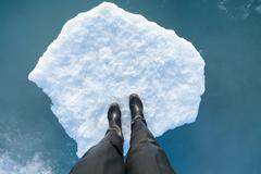 Human leg on a ice floe Stock Photos