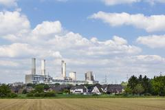 A decommissioned lignite power station behind a village Stock Photos