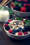Bowl of berries with oatmeal and chia - stock photo