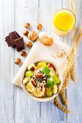 Bowl of fresh fruit. Healthy breakfast. - stock photo