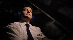 Pleased airman sitting in cockpit and navigating aircraft, enjoying his work Stock Footage