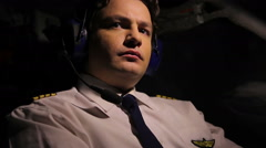 Tired pilot controlling airplane and thinking about home, stressful job - stock footage