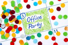 Reminder Office Party in calendar with confetti Stock Photos