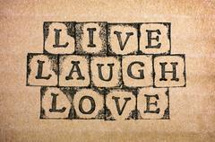 Words Live, Laugh, Love make by black alphabet stamps Stock Photos