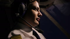 Pilot thinking about hijacking plan, cunning facial expression, camera zoom in Stock Footage