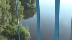 The fence of the bridge over the river Stock Footage