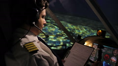 Pilot reading and filling out flight form, navigating plane in autopilot mode Stock Footage