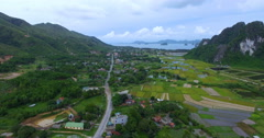 Aerial view of rice fields, mountains and sea Vietnam Stock Footage
