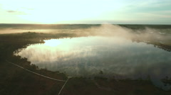 Aerial Shot of the Lake in Rural Area Early in the Morning. Stock Footage