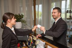 Businessman is arrived in hotel and is checking-in Stock Photos