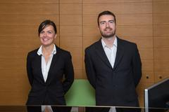 Portrait of the hotel reception staff - stock photo