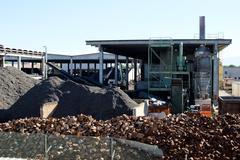 Metal demolishing factory and pile of recycled metal Stock Photos