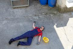 Worker in a faint after dramatic  injury - stock photo