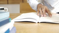 Man hand flip page of book and reading a book - stock footage