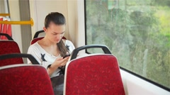 Young girl using smart phone during bus ride, Beautiful woman travelling Stock Footage