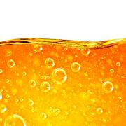 Liquid flows orange wave - stock photo