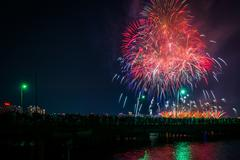 Fourth of July fireworks over the Broad Canal at night, in Cambridge, Massach Stock Photos