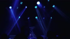 Silhouettes of dancing people on party in nightclub. Spotlights. Illuminations - stock footage