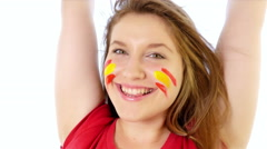 Girl with Spanish flag on her face smiling Stock Footage