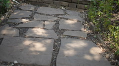 Stone walkway and stairs in the garden outdoors in summer Stock Footage