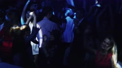 Crowd of dancing people on party in nightclub. Strobe. Illuminations. Holidays Stock Footage