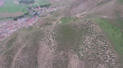 AERIAL TILT SHOT OF MOUNTAINS ON UPPER KORA MONK PATH IN XIAHE TIBET Stock Footage