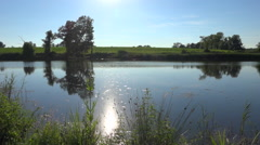 Panoramic shot on quiet natural pond - France - 50 fps Stock Footage