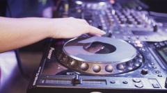 Dj girl in red dress spinning at turntable in nightclub. Equipment. Mix. Music Stock Footage