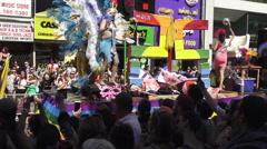 Parade float and Latin flags waving at the Toronto Pride Parade  Stock Footage
