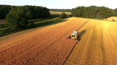 Harvesting crop at golden hour aerial view 4K Stock Footage