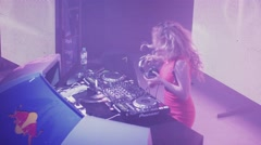 Dj girl in red dress dance at turntable in nightclub. Mixing. Shake hair Stock Footage