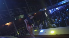 Mc girl in hare mask sexy red bodysuit perform on stage in nightclub. Raise hand Stock Footage