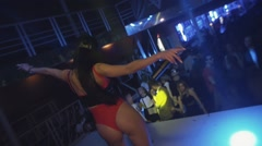 Mc girl in hare mask sexy red bodysuit dance on stage in nightclub. Wave booty Stock Footage