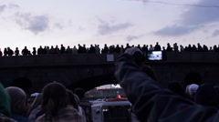 Tourists On Board See Crowd Of People Overhead On Bridge Stock Footage