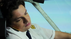 Sleepy tired pilot having fever while sitting in cockpit, health problems Stock Footage