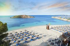 Idyllic Mediterranean beach sunrise Stock Photos