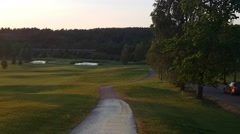 Sunset evening on a golf course, in Raasepori, Finland Stock Footage