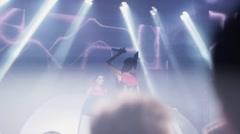 People dance in nightclub. Crowd. Mc girl and Dj girl perform on stage. Jump Stock Footage