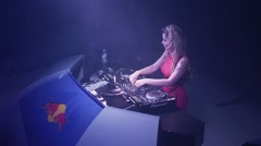 Dj girl in headphones spinning at turntable in nightclub. Artist. Holidays Stock Footage