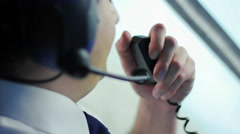 Airman talking to co-pilot by walkie-talkie and discussing flight details Stock Footage