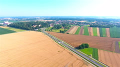 Aerial panorama view flat landscape with fields and road 4K Stock Footage