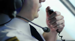 Airplane in turbulence, chief pilot reporting situation to flight dispatcher Stock Footage