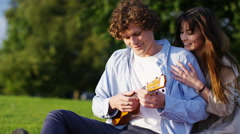 4K Attractive woman surprises her boyfriend as he plays an instrument - stock footage