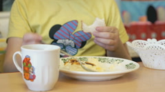 Child sitting at the table eating a scrambled - stock footage