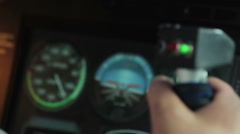 Rack focus of pilot hands steering plane and flight display with speedometer Stock Footage