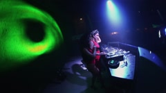 Sexy mc girl in hare mask and dj girl in red dress at turntable in nightclub Stock Footage