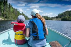 contryside ontario canada nature mother and child on a boat - stock photo